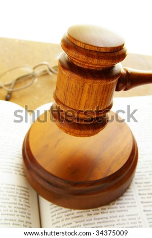 judges court gavel on a law book, with glasses