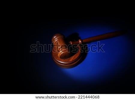 Judges court gavel on blue background                                - stock photo