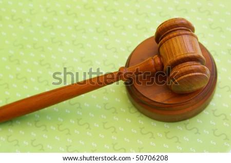 judges court gavel over dollar sign pattern - stock photo