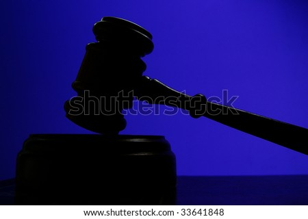 judges court gavel silhouette on blue background - stock photo