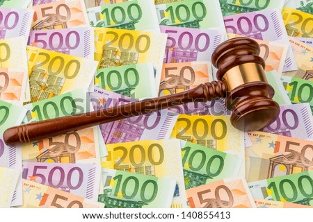 judges gavel and euro banknotes. symbol photo for costs in court of law and auctions