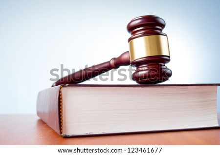 judges gavel and law book on a blue background