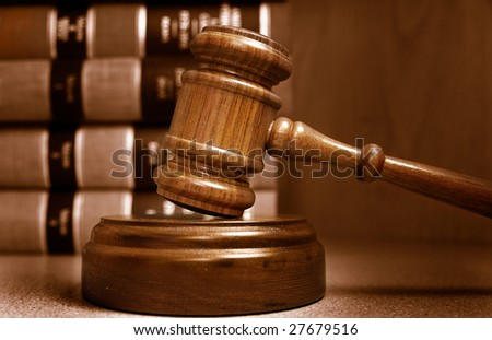 Judges gavel and law books stacked behind - stock photo