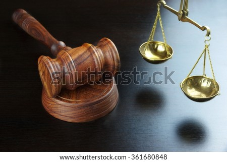 Judges Gavel And Scale Of Justice On The Black Table Background  In Back Light. Overhead View. Law Concept - stock photo