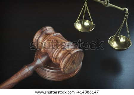 Judges Gavel And Scale Of Justice On The Black Table Background, Overhead View. Law Concept