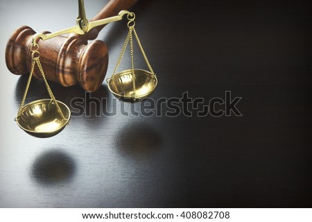 Judges Gavel And Scale Of Justice On The Black Wood Background, Top View. Law Concept - stock photo