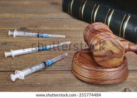 Judges Gavel,  Law Book,  Medical And Narcotic Drugs On Grunge Wood Table - stock photo