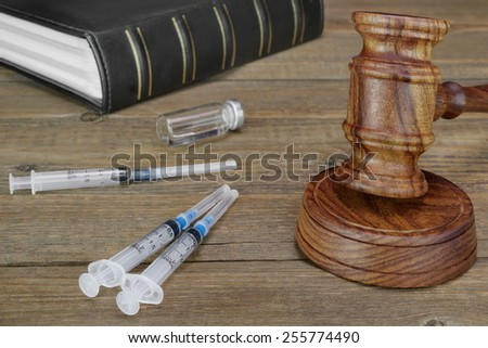 Judges Gavel,  Law Book,  Medical And Narcotic Drugs On Grunge Wood Table