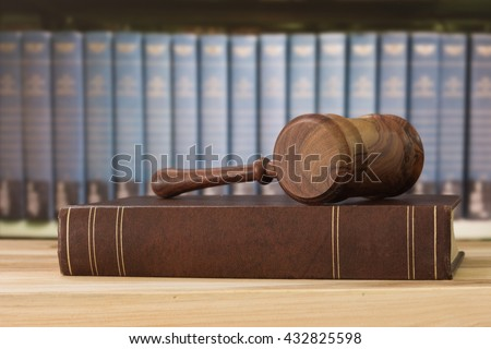 Judges gavel on law books with library background. Concept of legal education, cases study law. - stock photo