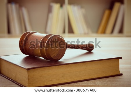 Judges gavel resting on top of the legal books. soft focus. Jurisprudence, law education concept.  - stock photo