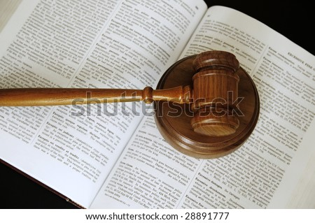 judges gavel sitting on an open law book - stock photo