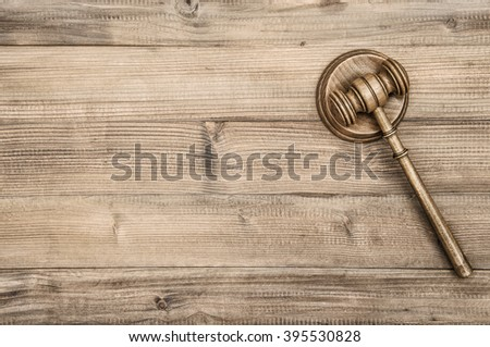 Judges Gavel with Soundboard. Auctioneer hammer on wooden background - stock photo