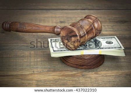 Judges or Auctioneer Gavel, Soundboard And Bundle Of Dollar Cash On The Rough Wooden Textured Table Background. Concept For Corruption, Bankruptcy Court, Bail, Crime, Bribing, Fraud, Auction Bidding. - stock photo