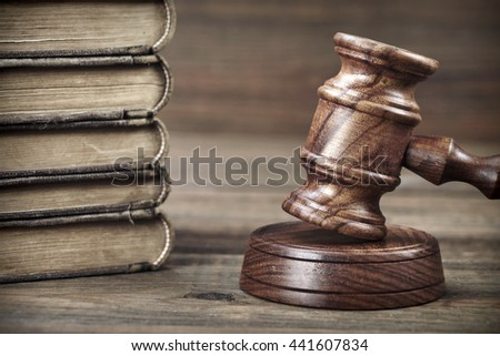 Judges Or Auctioneer Hammer And Old Shabby Law Book On Rough Wood Table, Close Up, Justice Or Auction Bidding Concept - stock photo