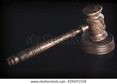 Judges Or Auctioneer Wooden Gavel Or Hammer On Grunge Black Table, Top View, Close Up - stock photo