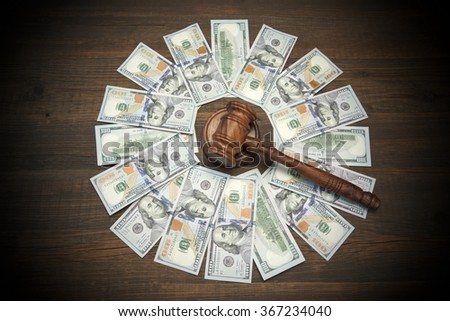 Judges Or Auctioneers Gavel And American Dollar Cash On Rough Wood Table Background, Overhead View, Conceptual Image - stock photo