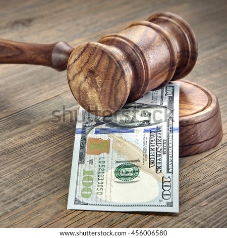 Judges or Auctioneers Gavel Or Hammer And Big Money Stack On Wooden Bench Or Wooden Table Background, Concept For Financial Crime, Close Up - stock photo