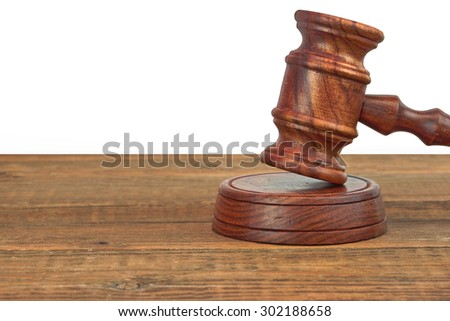 Judges Or Auctioneers Wood Rough Desk With Gavel On The Sound Board Isolated On White Background With Copy Space - stock photo