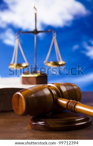 Judges wooden gavel, and bluse sky