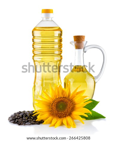 Jug and Bottle of Sunflower oil with flower and seeds isolated on white - stock photo