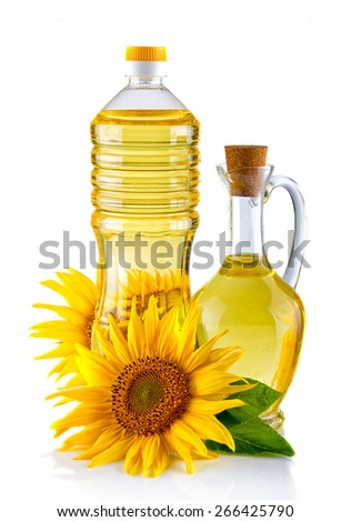Jug and Bottle of Sunflower oil with flower isolated on white background - stock photo