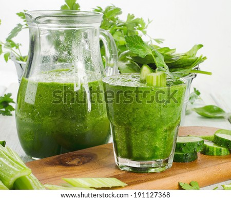 Jug and glass of Healthy green smoothie .  Selective focus