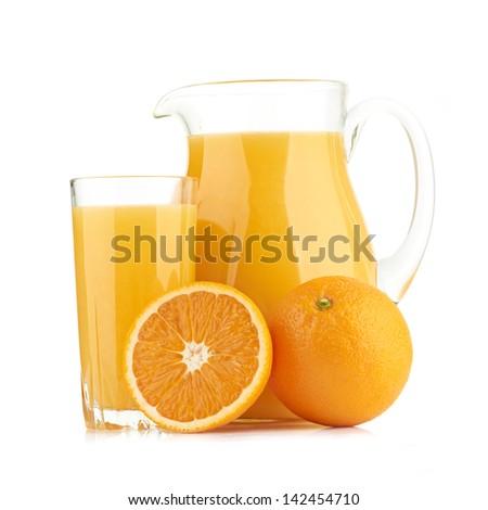 Jug, glass of orange juice and orange fruits - stock photo