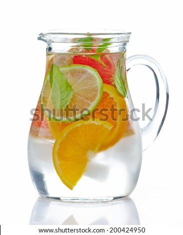 jug of cold nonalcoholic citrus fruit drink - stock photo