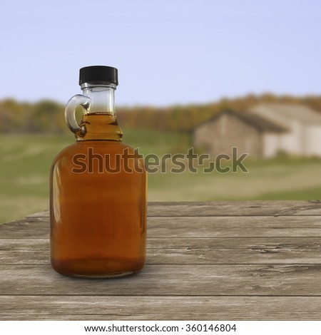 Jug of maple syrup outside on a table