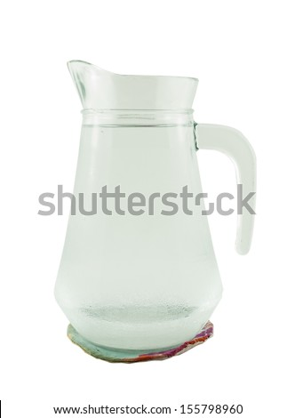 jug of water or glass carafe with coaster on white background - stock photo