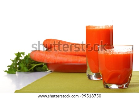 Juice and carrot isolated white kitchen prepare
