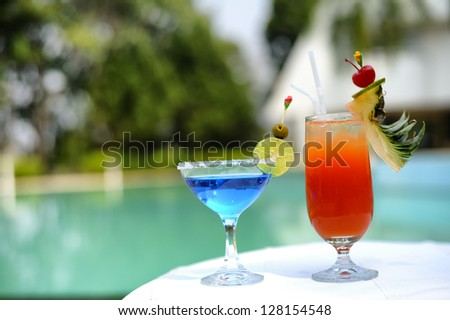 Juice at pool relaxation time concept - stock photo