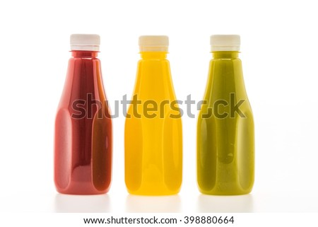 Juice bottles on white background