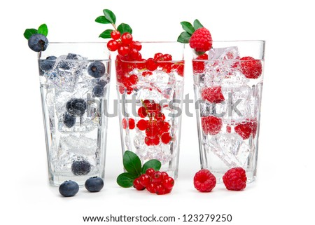 juice / cocktail with currant, raspberry, blueberry and ice, isolated on white background - stock photo