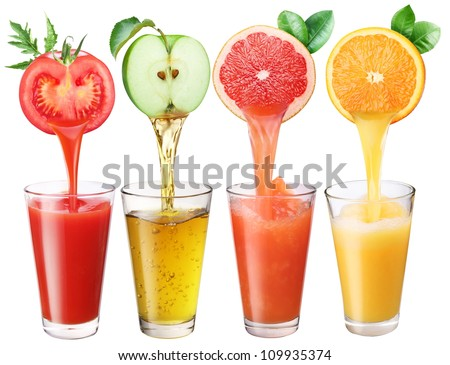 Juice flowing from fruits into the glass. - stock photo