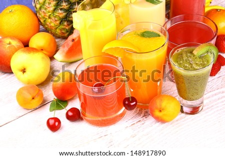 Juice from cherry, apricot, kiwi, watermelon and orange, top view