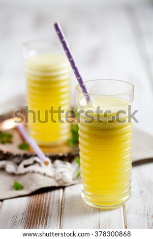 Juice from fresh pineapple, apple and lemon - stock photo