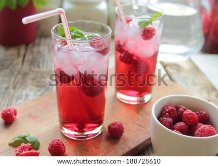 Juice from rasberries served with ice - stock photo