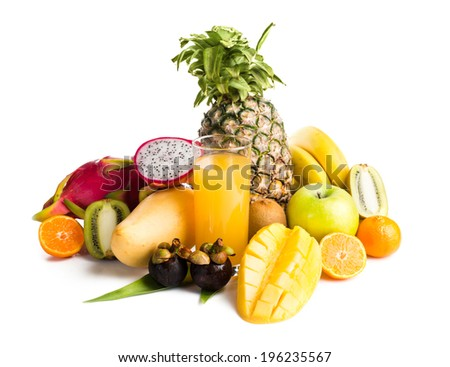 juice in glass and tropical fruit on white