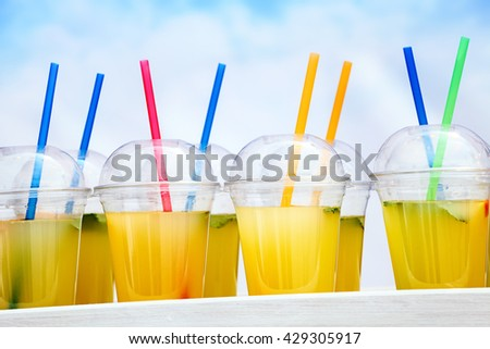 juice in glass with blue sky on background