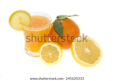 Juice in glass with fresh citrus fruit isolated on white