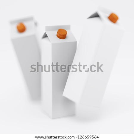 Juice in white rectangular packing, composition - stock photo