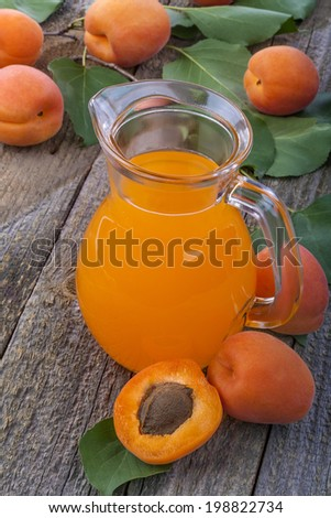 Juice of healthy organic apricots on the old rustic table