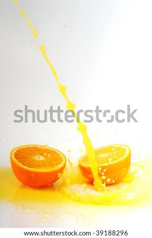 juice splashes on cut orange - stock photo