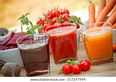 Juice squeezed from fresh vegetables - stock photo