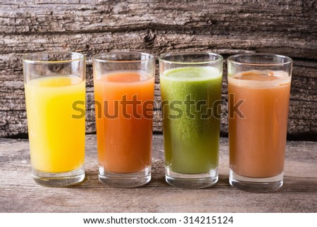 Juice with fruits ( kiwi , grapefruit , apple & orange )