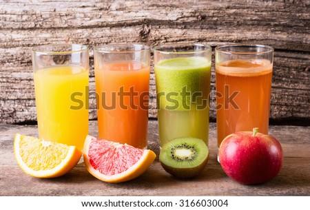 Juice with fruits ( kiwi , grapefruit , apple & orange ) - stock photo