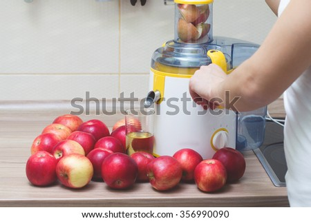 Juicer and fruit apple, with glass of freshness juice. - stock photo