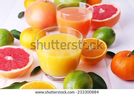 Juices and many citrus close-up - stock photo