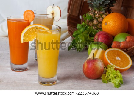 juices fresh orange, apple, carrot, in still life - stock photo